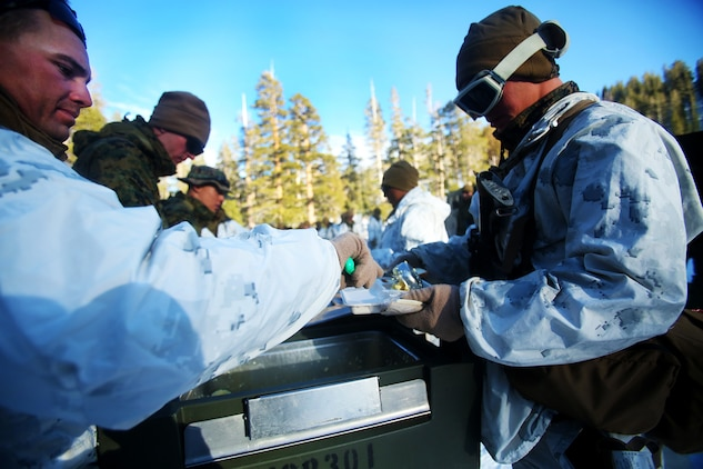 Marines are served warm food during a cold weather training exercise at the Mountain Warfare Training Center in Bridgeport, Calif., March 16, 2016. The Marines, combat engineers with 7th Engineer Support Battalion, 1st Marine Logistics Group, were among 90 Marines with 7th ESB who served as the logistics combat element in support of 2nd Battalion, 4th Marine Regiment, 1st Marine Division, during Mountain Exercise 6-16, Feb. 24- March 26, 2016. The Battalion integrated 18 combat engineers with the infantrymen conducting the exercise (U.S. Marine Corps photo by Sgt. Laura Gauna/released)