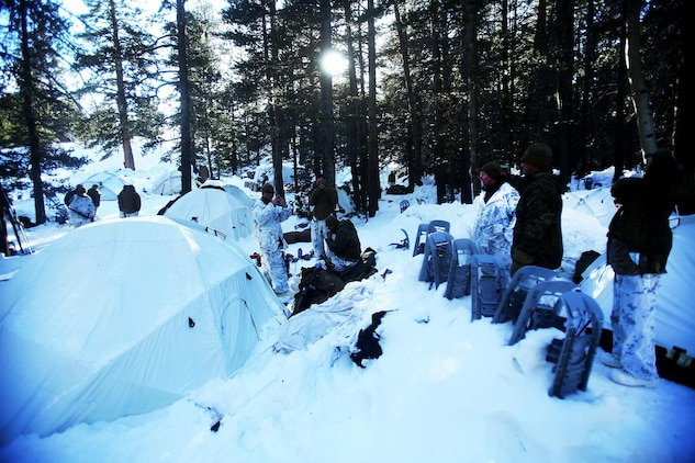 Marines wait for lunch by their tents during a cold weather training exercise at the Mountain Warfare Training Center in Bridgeport, Calif., March 16, 2016. The Marines, combat engineers with 7th Engineer Support Battalion, 1st Marine Logistics Group, were among 90 Marines with 7th ESB who served as the logistics combat element in support of 2nd Battalion, 4th Marine Regiment, 1st Marine Division, during Mountain Exercise 6-16, Feb. 24- March 26, 2016. The Battalion integrated 18 combat engineers with the infantrymen conducting the exercise. (U.S. Marine Corps photo by Sgt. Laura Gauna/released)