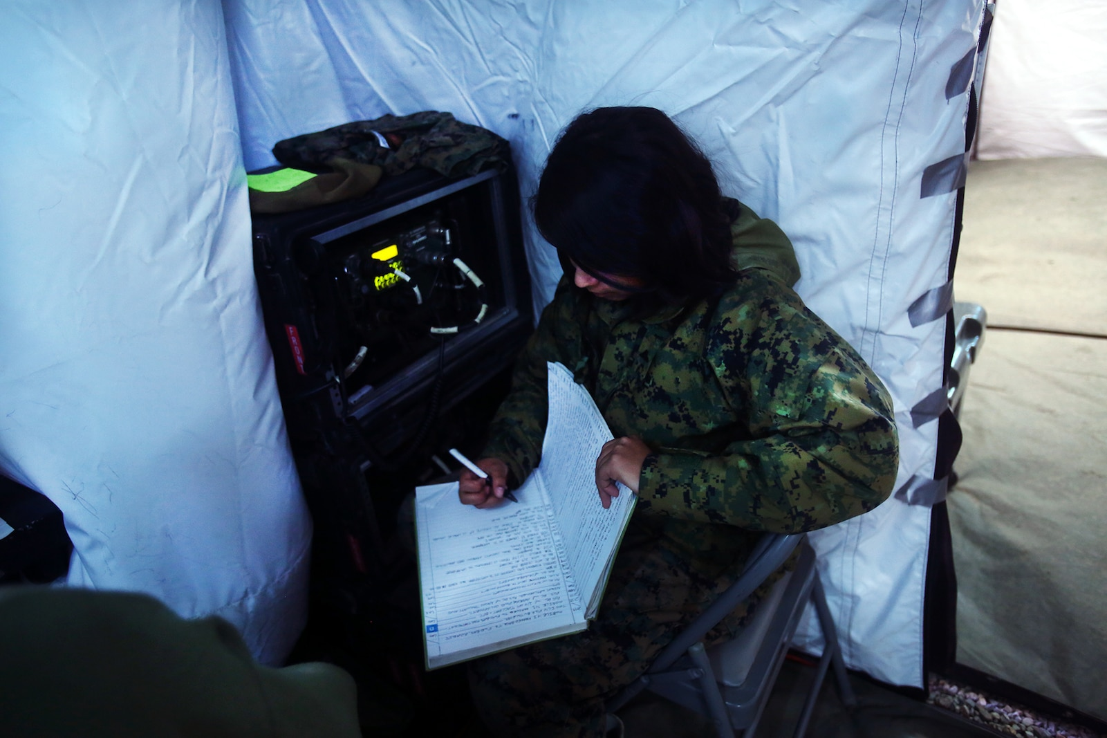 A field radio operator logs in a convoy movement during a cold weather training exercise at the Mountain Warfare Training Center in Bridgeport, Calif., March 17, 2016. The Marine, a field radio operator with Headquarters and Support Company, 7th Engineer Support Battalion, 1st Marine Logistics Group, was among 90 Marines with 7th ESB who served as the logistics combat element in support of 2nd Battalion, 4th Marine Regiment, 1st Marine Division, during Mountain Exercise 6-16, Feb. 24- March 26, 2016. (U.S. Marine Corps photo by Sgt. Laura Gauna/released)