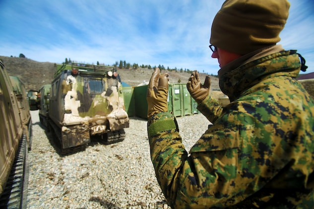U.S. Marine Cpl. Matthew McGill guides a small unit support vehicle (SUSV) during a cold weather training exercise at the Mountain Warfare Training Center in Bridgeport, Calif., March 17, 2016. McGill, a heavy equipment operator with Alpha Company, 7th Engineer Support Battalion, 1st Marine Logistics Group, was among 90 Marines with 7th ESB who served as the logistics combat element in support of 2nd Battalion, 4th Marine Regiment, 1st Marine Division, during Mountain Exercise 6-16, Feb. 24- March 26, 2016. (U.S. Marine Corps photo by Sgt. Laura Gauna/released)
