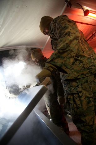 U.S. Marine Cpl. William Banks opens a freezer within the expeditionary field kitchen during a cold weather training exercise at the Mountain Warfare Training Center in Bridgeport, Calif., March 17, 2016. Banks, a food service specialist with Food Service Company, 1st Marine Logistics Group, was among 100 Marines with 1st MLG who served as the logistics combat element in support of 2nd Battalion, 4th Marine Regiment, 1st Marine Division, during Mountain Exercise 6-16, Feb. 24- March 26, 2016. (U.S. Marine Corps photo by Sgt. Laura Gauna/released)