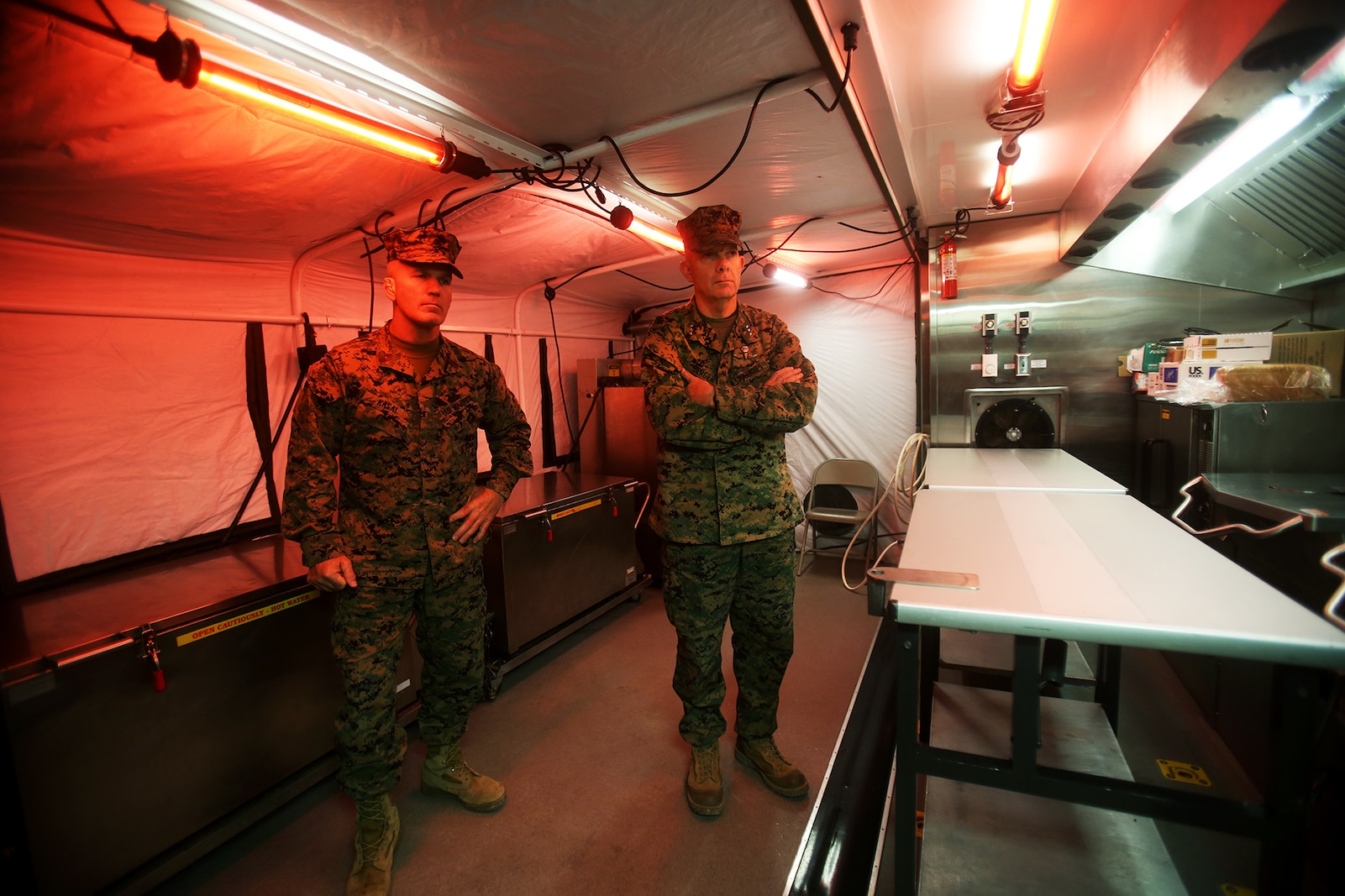 U.S. Marines Lt. Gen. David H. Berger and Sgt. Maj. Bradley Kasal learn about the expeditionary field kitchen during a cold weather training exercise at the Mountain Warfare Training Center in Bridgeport, Calif., March 17, 2016. Berger is the commanding general and Kasal is the sergeant major of I Marine Expeditionary Force. Approximately 90 Marines with 7th Engineer Support Battalion, 1st Marine Logistics Group, served as the logistics combat element in support of 2nd Battalion, 4th Marine Regiment, 1st Marine Division, during Mountain Exercise 6-16, Feb. 24- March 26, 2016. (U.S. Marine Corps photo by Sgt. Laura Gauna/released)