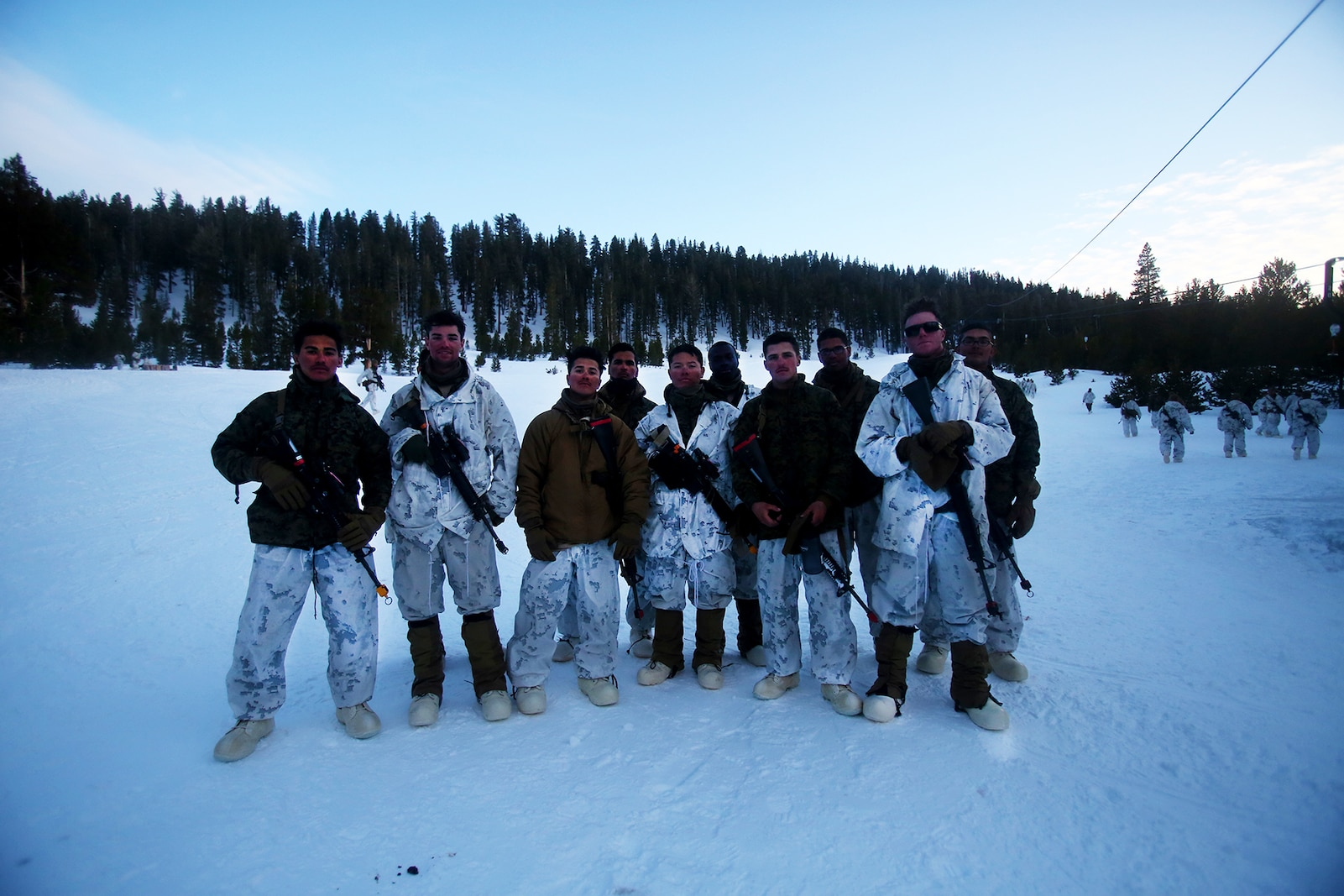 Marines pose for a photo during a cold weather training exercise at the Mountain Warfare Training Center in Bridgeport, Calif., March 16, 2016. The Marines, combat engineers with 7th Engineer Support Battalion, 1st Marine Logistics Group, were among 90 Marines with 7th ESB who served as the logistics combat element in support of 2nd Battalion, 4th Marine Regiment, 1st Marine Division, during Mountain Exercise 6-16, Feb. 24- March 26, 2016. The Battalion integrated 18 combat engineers with the infantrymen conducting the exercise. (U.S. Marine Corps photo by Sgt. Laura Gauna/released)