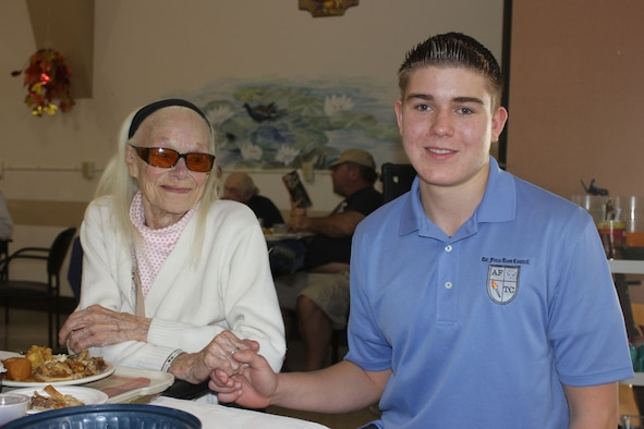 Ryan Pavey holds the hand of Lola Oliver while visiting the Veteran's Home of California in Yountville, Calif. (Courtesy photo)