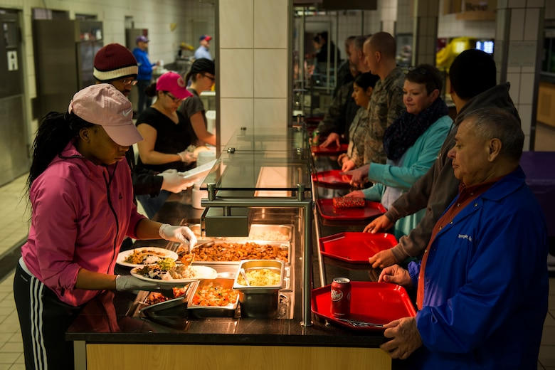 Members of the 52nd Force Support Squadron serve food to community members during the Messlords luncheon at the Mosel Dining Facility at Spangdahlem Air Base, Germany, March 30, 2016. More than 400 community members participated in the luncheon which consisted of Baja-themed dishes. (U.S. Air Force photo by Senior Airman Luke Kitterman/Released)