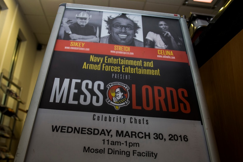 A sign promoting an upcoming Messlords visit is displayed inside the Mosel Dining Facility at Spangdahlem Air Base, Germany, March 29, 2016. The Messlords, a group of televised, business-owning chefs sponsored by Navy Entertainment and Armed Forces Entertainment, aim to entertain and cook for military members around the globe. (U.S. Air Force photo by Senior Airman Luke Kitterman/Released)