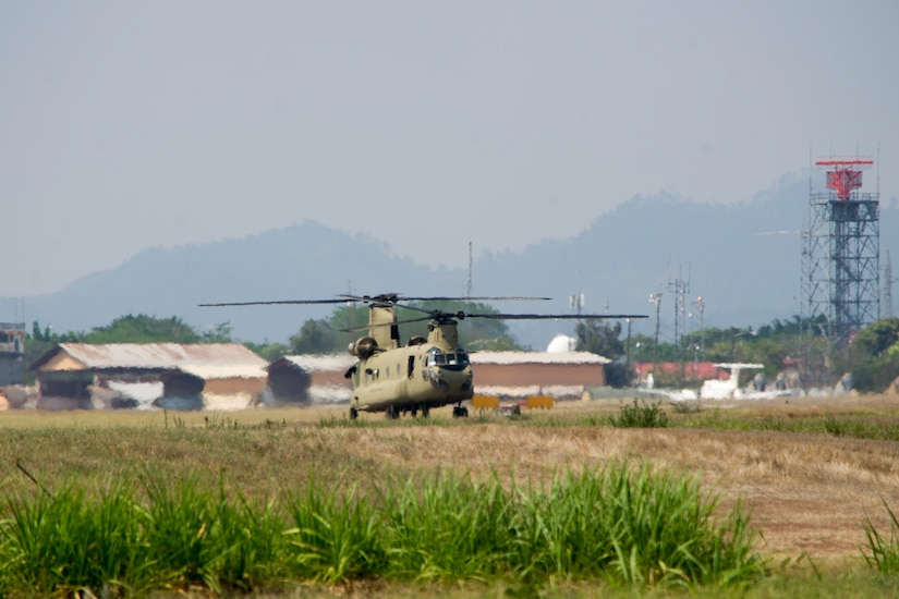 A U.S. Army CH-47 Chinook prepares to depart Soto Cano Air Base in support of firefighting efforts on the North coast of Honduras, Mar. 31, 2016, after Juan Orlando Hernandez, President of Honduras, sent a request for support to the U.S. Ambassador in Honduras. The aircraft was one of several which responded from Joint Task Force-Bravo, aiding the Honduran Fire Department, Army and Air Force already working to control the fire in the Jeanette Kawas National Park. (U.S. Air Force photo by Capt. Christopher Mesnard/Released)