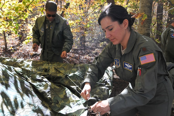 U.S. Air Force Maj. Jennifer Lacy builds a shelter during Combat Survival Refresher training held Nov. 3, 2013. This training aims to enhance the survivability and combat readiness of aircrew. Lacy has since been promoted to the rank of lieutenant colonel and currently serves as commander of the 145th Force Support Squadron. (U.S. Air National Guard photo by Master Sgt. Richard Kerner/Released)