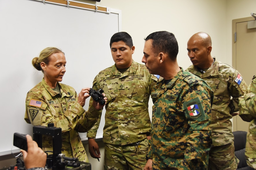 U.S. Army Staff Sgt. Michelle Lewis, an aviation life support equipment (ALSE) NCO technician assigned to the 1-135th Attack Reconnaissance Battalion, demonstrates proper maintenance procedures for Night Vision Goggles (NVGs) to members of the Panamanian Public Forces at Whiteman Air Force Base, Mo., March 16, 2016. The visit, part of the ongoing State Partnership Program between the Missouri National Guard and the Panamanian Public Forces, enabled subject matter exchanges between the two partners.