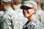 Capt. Kristen Griest smiles at friends and family as she waits with her U.S. Army Ranger School Class to graduate at Fort Benning, Ga., Aug. 21, 2015. Griest and class member 1st Lt. Shaye Haver became the first female graduates of the school. Army photo by Staff Sgt. Steve Cortez