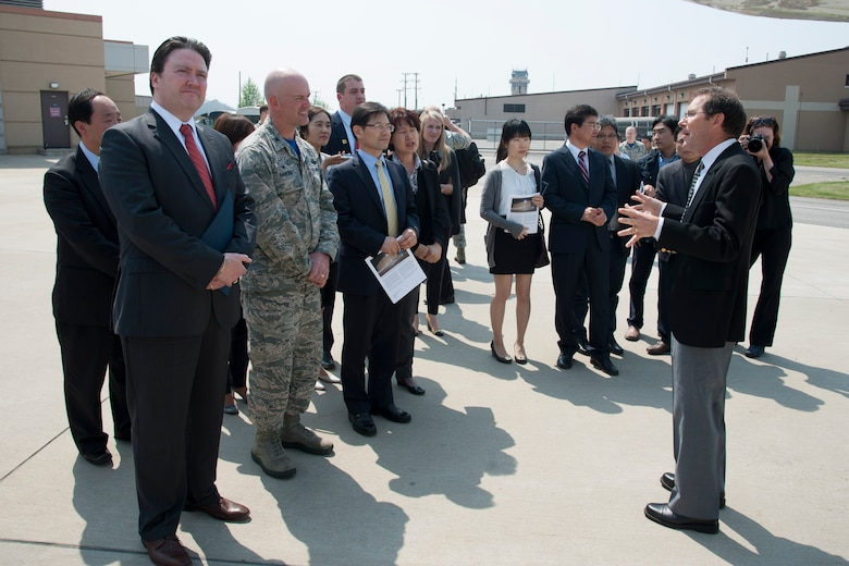 James Crawford, NASA lead U.S. scientist for Korea United States-Air Quality (KORUS-AQ) Experiment, gives an overview of the aircraft that will be participating in the KORUS-AQ to Marc Knapper, U.S. Embassy Seoul deputy chief of mission, and 51st Fighter Wing Commander, Col. Andrew Hansen, at Osan Air Base, Republic of Korea, April 29, 2016. KORUS-AQ is a joint field study by NASA and the National Institute of Environmental Research that will advance the ability to monitor air pollution more accurately from space. (U.S. Air Force photo by Staff Sgt. Jonathan Steffen/Released