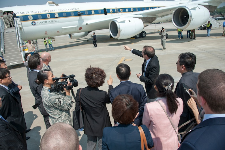 James Crawford, NASA lead U.S. scientist for Korea United States-Air Quality (KORUS-AQ) Experiment, points out the NASA DC-8 jet that will be participating on the Korea United States-Air Quality (KORUS-AQ) Experiment at Osan Air Base, Republic of Korea, April 29, 2016.  KORUS-AQ will collect air quality data over the Republic of Korea using aircraft, ground sites and ships from May 2 until June 12. The U.S. and South Korean aircraft will conduct coordinated flights from Osan Air Base. (U.S. Air Force photo by Staff Sgt. Jonathan Steffen/Released)