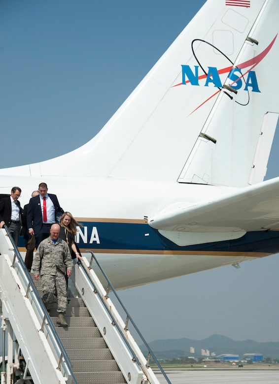 Col. Andrew Hansen, 51st Fighter Wing commander, walks off the NASA DC-8 that is part of the Korea United States-Air Quality (KORUS-AQ) Experiment at Osan Air Base, Republic of Korea, April 29, 2016. KORUS-AQ will collect air quality data over the Republic of Korea using aircraft, ground sites, and ships from May 2 until June 12. The U.S. and South Korean aircraft will conduct coordinated flights from Osan Air Base. (U.S. Air Force photo by Staff Sgt. Jonathan Steffen/Released)