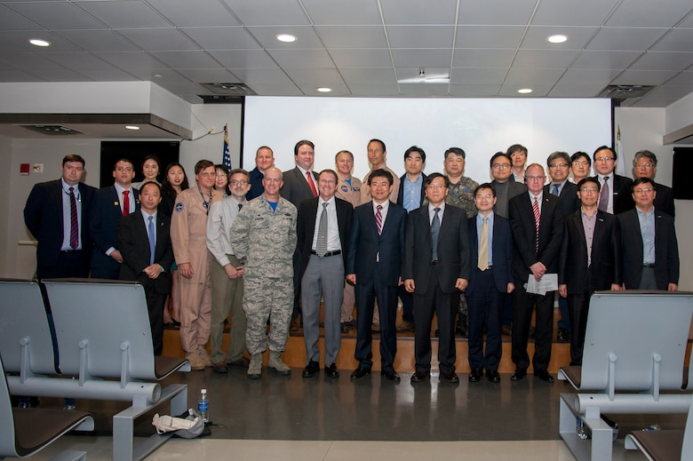 Marc Knapper, U.S. Embassy Seoul deputy chief of mission, and Col. Andrew Hansen, 51st Fighter Wing commander, pose for a group photo with the Korea United States-Air Quality (KORUS-AQ) Experiment team and distinguished visitors at the media day on Osan Air Base, Republic of Korea, April 29, 2016. KORUS-AQ will collect air quality data over the Republic of Korea using aircraft, ground sites and ships from May 2 until June 12. The U.S. and South Korean aircraft will conduct coordinated flights from Osan Air Base. (U.S. Air Force photo by Staff Sgt. Jonathan Steffen/Released)