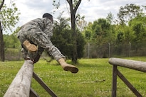 A soldier jumps over a log obstacle course the Ordnance Group Team of the Year 2016 competition at the Wendell H. Ford Regional Training Center in Greenville, Ky., April 25, 2016. Army photo by Pfc. Aaron Bratcher