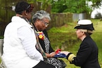 Chief of Navy Reserve Vice Adm. Robin Braun presents a U.S. flag to Bernadette Maybelle Parks Ricks, great-granddaughter of Medal of Honor recipient Joseph B. Noil, during a ceremony at St. Elizabeths Hospital cemetery in Washington, D.C., April 29, 2016. Noil received the Medal of Honor for actions while serving on the USS Powhatan in 1872, but his headstone did not recognize his award due to a misprint on his death certificate. Navy photo by Petty Officer 2nd Class Eric Lockwood