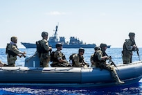Members of the visit, board, search, and seizure team for the USS Gonzalez operate a rigid-hull inflatable boat in the Gulf of Aden, April 26, 2016. The giuded-missile destroyer is supporting Operation Inherent Resolve, maritime security operations and theater security cooperation efforts in the U.S. 5th Fleet area of operations. Navy photo by Petty Officer 3rd Class Pasquale Sena
