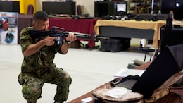 "A Japan Ground Self-Defense Force member visiting the annual Training Expo at Camp Hansen, Okinawa, Japan tests out the Instrumental Tactical Evaluation Simulated System on Friday, April 29, 2016. This recently updated system works almost like the popular game, ""laser tag,"" where a laptop traces the marksmanship of the shooter. This training can be recorded and handed back to the unit on a CD to evaluate performance."