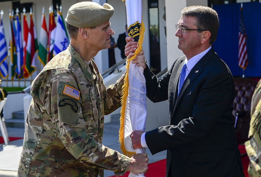 "Army Gen. Joseph L. Votel, former commander of U.S. Special Operations Command, passes the guidon to Secretary of Defense, Ashton Carter, during the change-of-command ceremony March 30, 2016, at MacDill Air Force Base, Fla. Newly promoted Army Gen. Raymond ""Tony"" Thomas assumed command of USSOCOM and Votel will become the commander of U.S. Central Command. (Courtesy photo)"