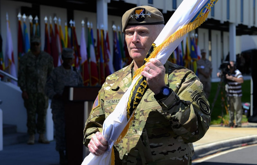"Army Gen. Raymond ""Tony"" Thomas, holds the guidon after assuming command of USSOCOM Mar. 30, 2016, at MacDill Air Force Base, Fla. The former Commander, Army Gen. Joseph L. Votel, will become the commander of U.S. Central Command. (Courtesy photo)"