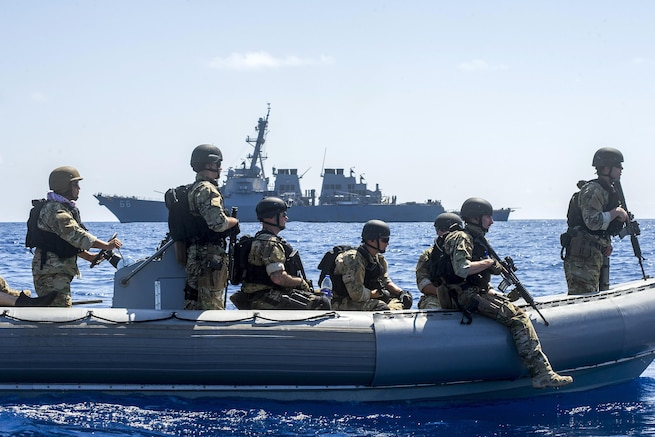 Sailors assigned to the guided-missile destroyer USS Gonzalez's visit, board, search, and seizure team operate a rigid-hull inflatable boat in the Gulf of Aden, April 26, 2016. The Gonzalez is deployed as part of the Harry S. Truman Carrier Strike Group in support of Operation Inherent Resolve, maritime security operations and theater security cooperation efforts in the U.S. 5th Fleet area of operations. Navy photo by Petty Officer 3rd Class Pasquale Sena