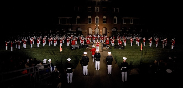 Marines from at Marine Barracks Washington,D.C., perform during the Friends and Family Evening Parade, D.C., April 29, 2016. The guest of honor for the evening was Gen. Robert Neller, commandant of the Marine Corps, and the hosting official was Col. Benjamin T. Watson, commanding officer, MBW.(Official Marine Corps photo by Staff Sgt. Michael Coleman/Released)