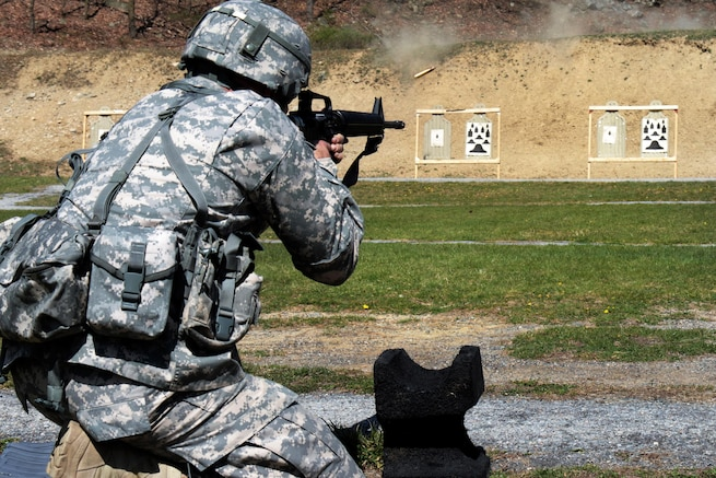 Army Spc. Corey Berke fires an M16 rifle from the kneeling position during the weapons qualification event for the Best Warrior Competition at Camp Smith Training Site, N.Y., April 21, 2016. Berke is a network systems operator assigned to the New York Army National Guard. Army National Guard photo by Sgt. Michael Davis