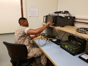 Lance Corporal George E. Watford Jr.is testing an RT-1694 Harris radio with one of the Marine Corps newest pieces of test equipment.  This prepares Ground Radio Repair Marines to employ and troubleshoot ground radio communication equipment for the Operational Marine Forces.  Lance Corporal Watford is currently a student in the Ground Radio Repair Course and has maintained a 93% grade point average.