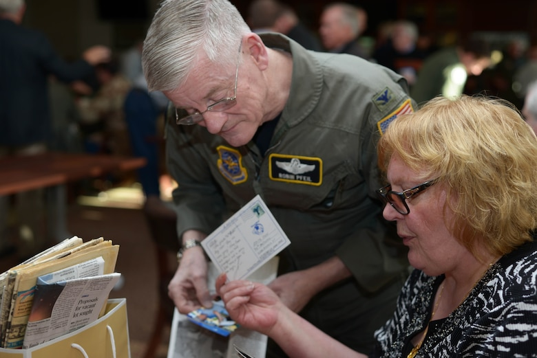 Col. (retired) Robin Pfeil, 914 Airlift Wing, former Vice Commander, and Edith Fose, General Manager, base lodging, look through old post cards and photos during the Desert Storm 25th Anniversary reunion, April 9, 2016, Niagara Falls Air Reserve Station. (U.S. Air Force photo by Staff Sgt. Richard D. Mekkri)