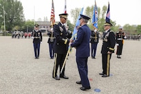Army Gen. Vincent K. Brooks takes the U.S. Forces Korea colors from Air Force Gen. Paul J. Selva, vice chairman of the Joint Chiefs of Staff, during a change-of-command ceremony in Yongsan Garrison in South Korea, April 30, 2016. During the ceremony, Brooks took command of United Nations Command, Combined Force Command and U.S. Forces Korea. Army photo by Sgt. Russell Youmans