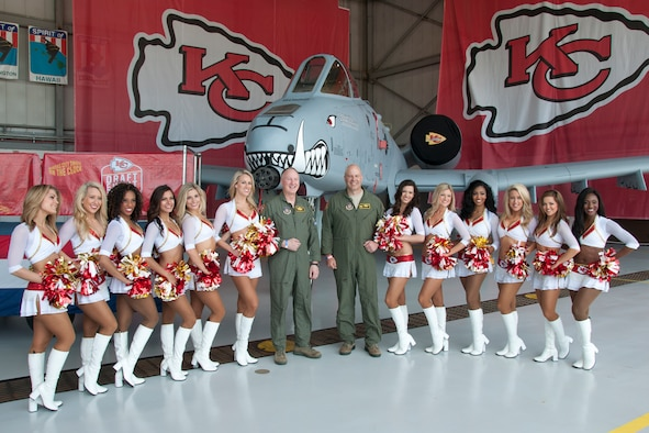 Col. Greg Eckfeld (left) and Col. Brian Borgen, vice commander and commander of the 442d Fighter Wing respectively, meet with the Kansas City Chiefs cheerleaders during the Military Appreciation Day event at Whiteman Air Force Base, Mo., April 30, 2016. Service members and their families enjoyed photo-ops and autographs with the Chiefs cheerleaders and players, among other activities. (U.S. Air Force photo by Airman 1st Class Missy Sterling/Released)