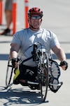 Army 1st Lt. Christopher Parks competes in the men's hand cycle event during the Army trials at Fort Bliss, Texas, March 29, 2015. He overcame a rare illness to make the team and will compete at the Invictus Games held May 8-12 in Orlando, Fla. DoD photo by EJ Hersom