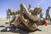 A U.S. airman wrestles with a Dutch soldier after being exposed to pepper spray during a nonlethal weapons class as part of African Lion 16 in Tifnit, Morocco, April 23, 2016. Air Force photo by Senior Airman Krystal Ardrey