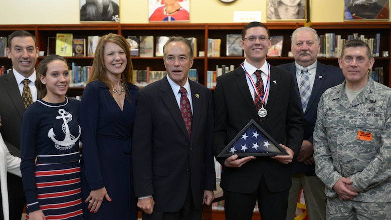 Gabriel Curcione poses with family and members of the community, Friday, April 22, 2016, after receiving the Congressional Silver Medal at Wilson High School in Wilson, New York. Curcione received the award after performing more than 400 hundred hours of volunteerism, community service, and personal development. (U.S. Air Force photo by Staff Sgt. Richard Mekkri)