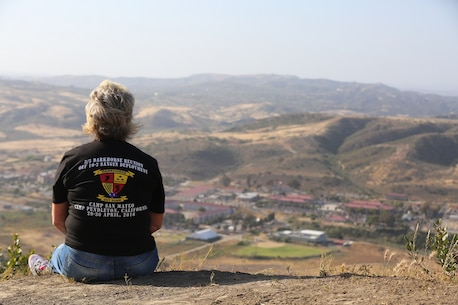 "MARINE CORPS BASE CAMP PENDLETON, Calif. – Kathy Sims gazes at San Mateo from the top of First Sergeant's Hill while Marines honor their fellow comrades during the Dark Horse Reunion at Camp Pendleton April 29, 2016. Sims is the 3rd Battalion, 5th Marine Regiment ""Dark Horse"" Reunion organizer. (U.S. Marine Corps photo by Lance Cpl. Shellie Hall/Released)"