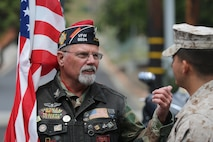 """MARINE CORPS BASE CAMP PENDLETON, Calif. – Bob Pruitt speaks with a Marine before the start of the 3rd Battalion, 5th Marine Regiment """"Dark Horse"""" Reunion at the San Mateo Memorial Garden April 29, 2016. Pruitt, a Vietnam War veteran and former Navy petty officer, is now a Patriot Guard Rider. (U.S. Marine Corps photo by Lance Cpl. Shellie Hall/Released)"""