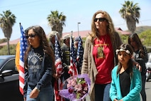 """MARINE CORPS BASE CAMP PENDLETON, Calif. – Family and friends walk past the Patriot Guard Riders before entering the San Mateo Memorial Garden on Camp Pendleton April 29, 2016. The family and friends attended the 3rd Battalion, 5th Marine Regiment """"Dark Horse"""" Reunion to honor the Marines who were deployed to Sangin, Afghanistan in the fall of 2010. (U.S. Marine Corps photo by Lance Cpl. Shellie Hall/Released)"""