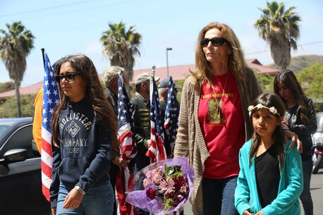 "MARINE CORPS BASE CAMP PENDLETON, Calif. – Family and friends walk past the Patriot Guard Riders before entering the San Mateo Memorial Garden on Camp Pendleton April 29, 2016. The family and friends attended the 3rd Battalion, 5th Marine Regiment ""Dark Horse"" Reunion to honor the Marines who were deployed to Sangin, Afghanistan in the fall of 2010. (U.S. Marine Corps photo by Lance Cpl. Shellie Hall/Released)"
