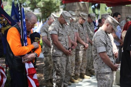 "MARINE CORPS BASE CAMP PENDLETON, Calif. – Jim Reed bows his head in prayer during the 3rd Battalion, 5th Marine Regiment ""Dark Horse"" Reunion at the San Mateo Memorial Garden April 29, 2016. Reed, a retired Navy master chief and Vietnam War veteran, served 23 years and is now a Patriot Guard Rider. (U.S. Marine Corps photo by Lance Cpl. Shellie Hall/Released)"