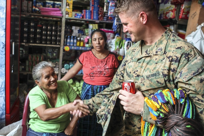 Marine Corps Capt. James Atkinson greets a resident before an upcoming Medical Readiness Exercise in La Blanca, Guatemala, April 29, 2016. Task Force Red Wolf and Army South conducted civil assistance training with Guatemalan government and nongovernment agencies to improve the mission readiness of U.S. forces and provide a lasting benefit to the Guatemalan people. Army photo by Spc. Glenaj Washington