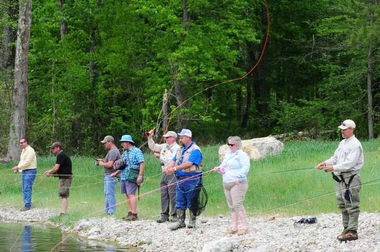 """After officials dedicated Hatchery Creek in Jamestown, Ky., April 29, 2016, the public participated in the """"first cast"""" to culminate the ceremony."""