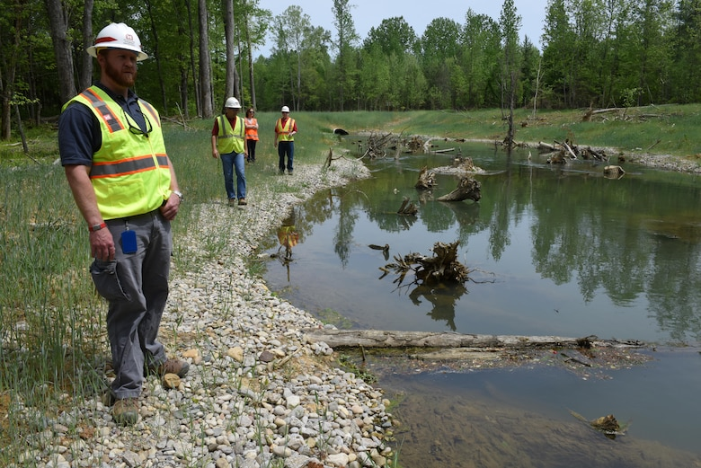 U.S. Army Corps of Engineers Nashville District employees check out a section of Hatchery Creek below Wolf Creek National Fish Hatchery April 29, 2016.  They toured the Hatchery Creek Restoration Project site just prior to the dedication ceremony.