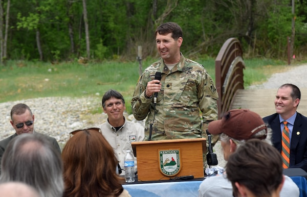 Lt. Col. Stephen Murphy, U.S. Army Corps of Engineers Nashville District commander, speaks during the Hatchery Creek Dedication in Jamestown, Ky., April 29, 2016.  He talked about how the Hatchery Creek Restoration Project gave the Corps of Engineers enough top soil to cover a 40-acre disposal area filled with limestone rock, concrete and clay from the Wolf Creek Dam Safety Rehabilitation Project.  The Corps spent $650,000 to excavate the soil, but used about 56,000 cubic yards of top soil excavated from the channel with savings of almost a million dollars.