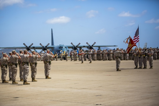The 4th Marine Aircraft Wing color guard team march on the colors at a change of command ceremony at Marine Corps Air Station Miramar, California, April 29, 2016. Maj. Gen. William T. Collins relinquished command of 4th MAW to Brig. Gen. Bradley S. James, the previous assistant wing commander of 4th MAW.