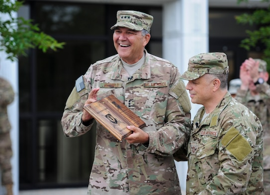 Lt. Gen. Brad Heithold, commander of Air Force Special Operations Command, accepts his Order of the Sword invitation from Chief Master Sgt. Matt Caruso, AFSOC command chief, at Hurlburt Field, Fla., May 2, 2016. The Order of the Sword is the highest award the enlisted corps can bestow upon an officer, draws its heritage from military tradition where non-commissioned officers honor leaders who have made significant contributions to the enlisted corps. Heithold will be inducted Nov. 18, 2016 here. (U.S. Air Force photo by Senior Airman Meagan Schutter)