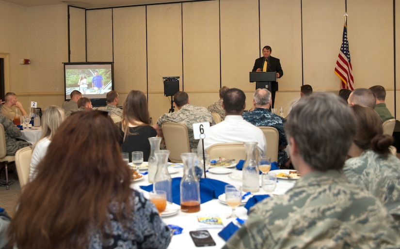 Jason Bowen, a Charleston County Sherriff's Office Special Victims Unit detective, speaks at the Child Abuse Prevention Luncheon April 26, 2016 at Joint Base Charleston . During his speech Bowen gave tips on how to prevent children from becoming victims of cyber predators. (U.S. Air Force Photo/Airman Megan Munoz)