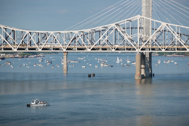 Airmen from the Kentucky Air National Guard's 123rd Special Tactics Squadron recover combat controllers and pararescuemen from the Ohio River after a demonstration of their capabilities during the Thunder Over Louisville air show in downtown Louisville, Ky., April 23, 2016. The event drew an estimated crowd of 725,000 spectators. (U.S. Air National Guard photo by Maj. Dale Greer)