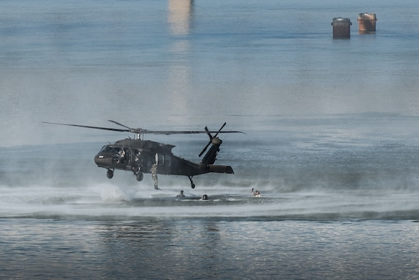Combat controllers and pararescuemen from the Kentucky Air National Guard's 123rd Special Tactics Squadron jump from a Kentucky Army National Guard UH-60 Blackhawk helicopter into the Ohio River during the Thunder Over Louisville air show in downtown Louisville, Ky., April 23, 2016. The demonstration displays techniques the Airmen use when recovering downed personnel or executing a covert insertion into enemy territory. (U.S. Air National Guard photo by Maj. Dale Greer)