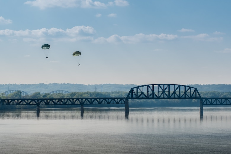 Two bundles of cargo descend to the Ohio River after being airdropped by a Kentucky Air National Guard C-130 Hercules transport plane during the Thunder Over Louisville air show in downtown Louisville, Ky., April 23, 2016. The event drew an estimated crowd of 725,000 spectators to the banks of the Ohio River. (U.S. Air National Guard photo by Maj. Dale Greer)