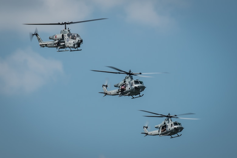 Pilots from the U.S. Marine Corps showcase the capabilities of the AH-1 Super Cobra (left) and UH-1 Huey helicopters during the Thunder Over Louisville air show in downtown Louisville, Ky., April 23, 2016. The event drew an estimated crowd of 725,000 spectators to the banks of the Ohio River. (U.S. Air National Guard photo by Maj. Dale Greer)